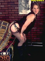 This mature biker chick gives you a striptease